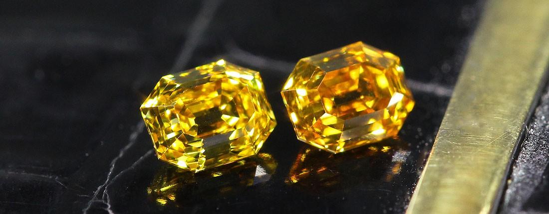 fancy yellow orange pair elongated emerald cut diamonds