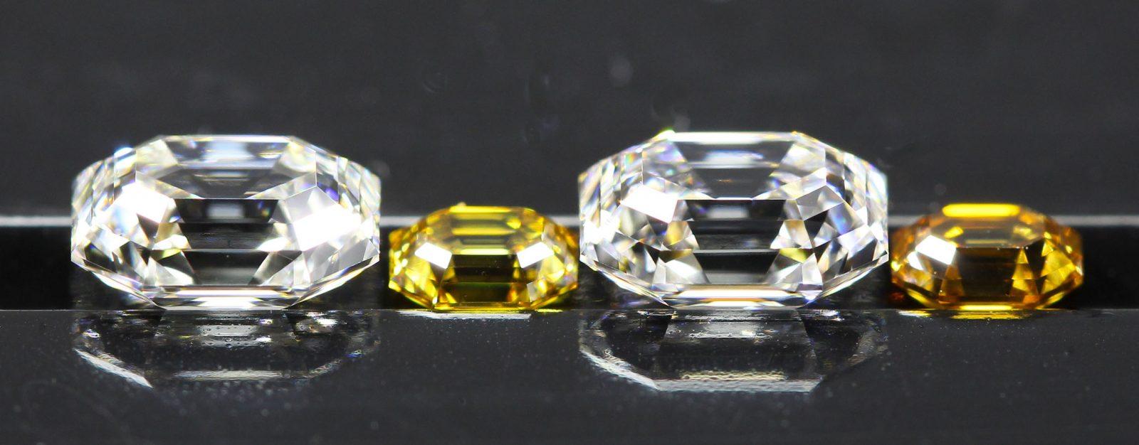 Two pairs of elongated Emerald Cut Diamonds