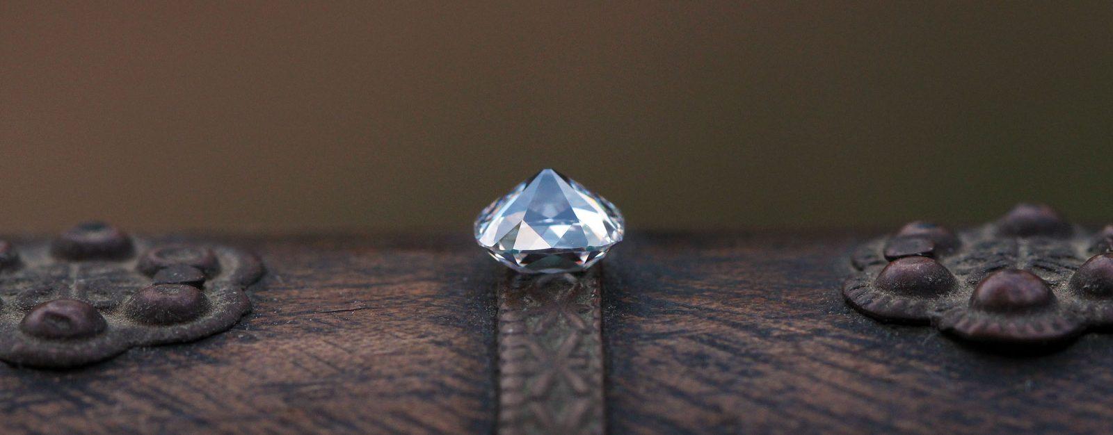 Innovative Old Mine Cut Diamond over wood