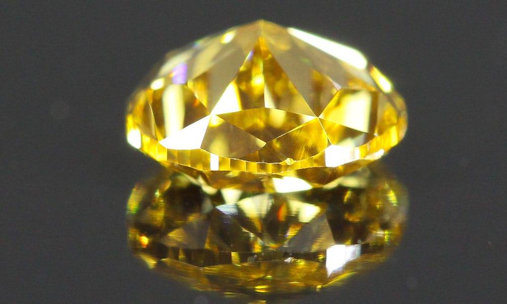 A beautiful Fancy Intense Orangey Yellow Pear Shape Diamond