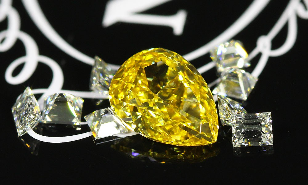 A beautiful Fancy Intense Orangey Yellow Pear Shape Diamond