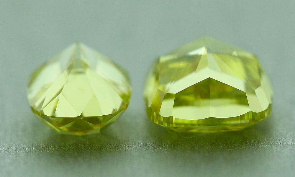 Two fancy vivid yellow color diamonds in the table-down position