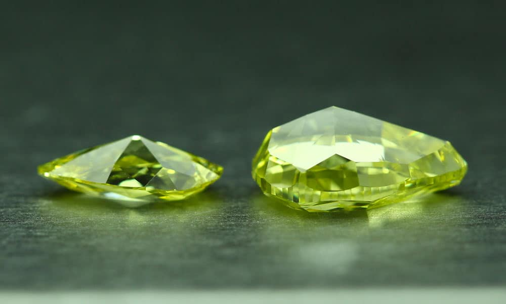 Two pear shaped fancy vivid yellow diamonds