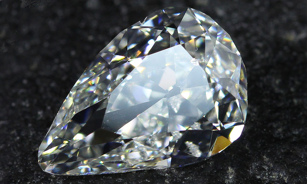 Mismatched Pair of Old Mine Pear Cut Diamonds close up
