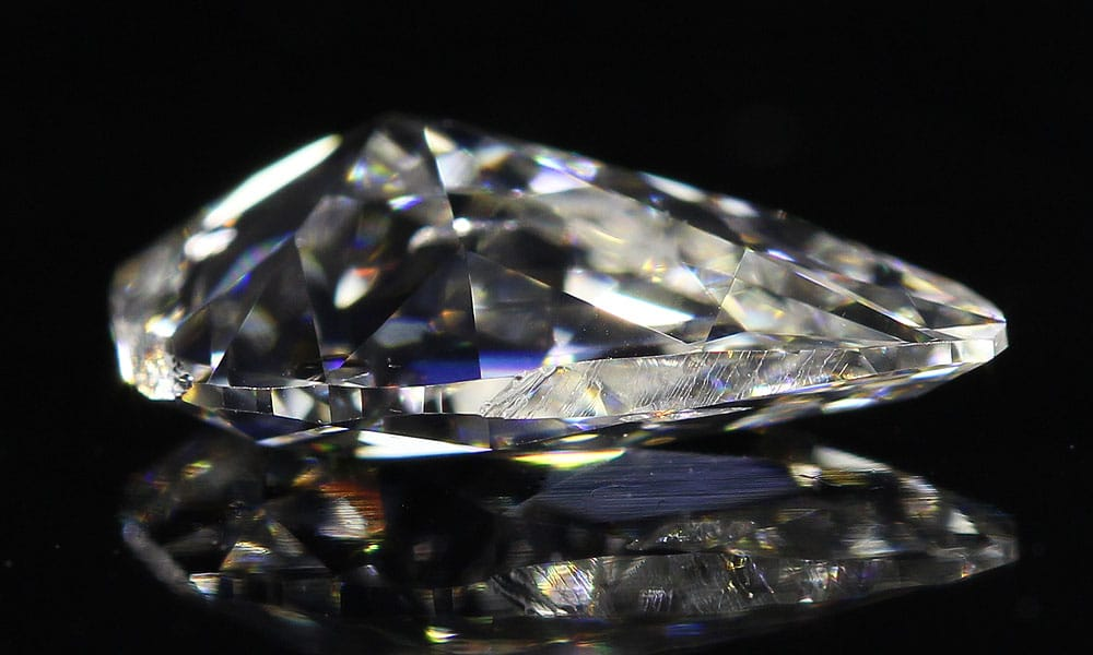 Mismatched Pair of Old Mine Pear Cut Diamonds side view