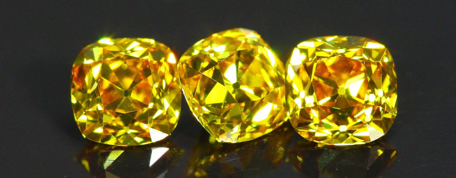 Orange-Yellow three stone Old Mine Cut Diamond suite