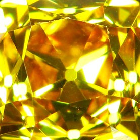Orange-Yellow Old Mine Cut three stone