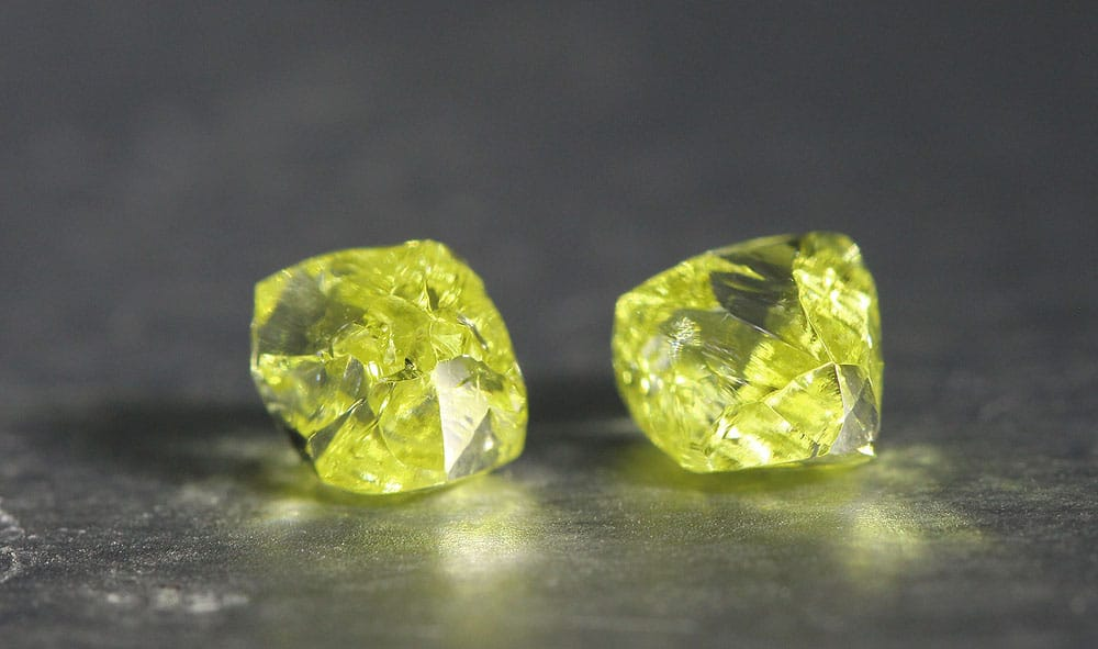A pair of fancy yellow rough diamond crystals