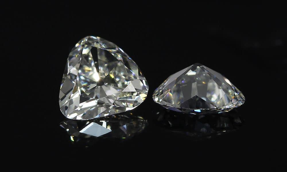 0.56 carat Old mine triangular pair
